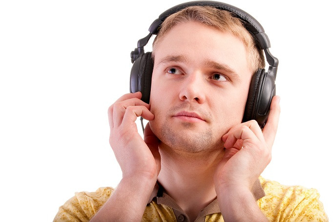 Young man listens to beautiful music.